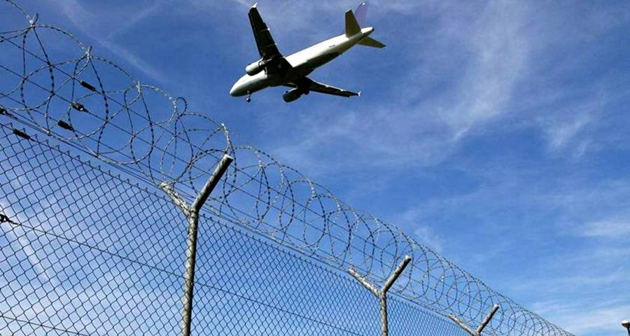 Airport Perimeter Fence With Warning Sign In The