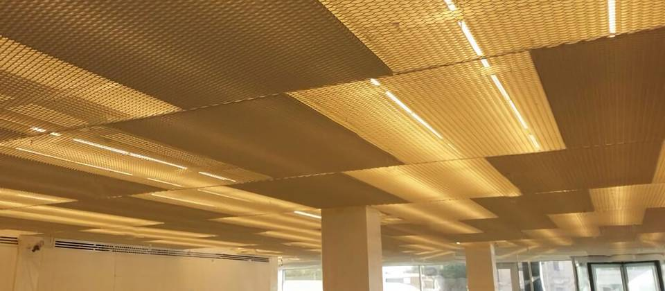 Expanded Mesh Ceiling In Office Administrative Building