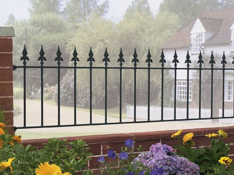 3ft Iron Fence Installed On A Wall Top Between Columns