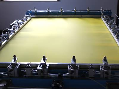 Brass papermaking wire mesh screen on papermaking machine.