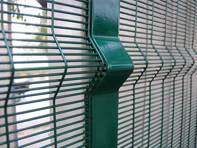 """A close-up picture of 3D 358 high security fence with pressed horizontal """"V"""" shaped beams."""
