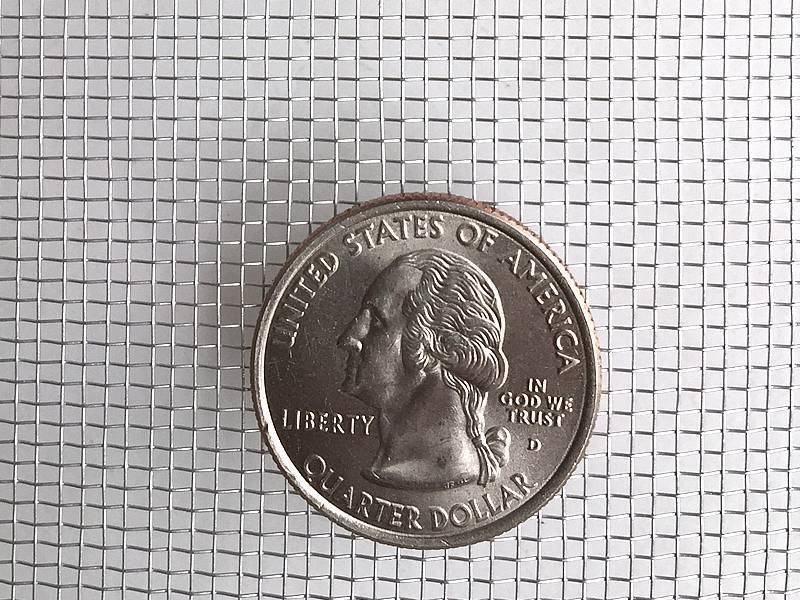 This is one piece of aluminum woven wire mesh, with one coin shown to illustrate scale.