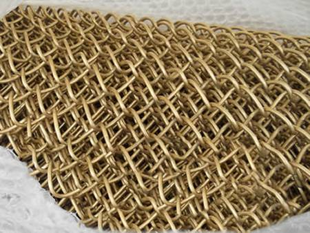 Chain link copper alloy fish mesh.