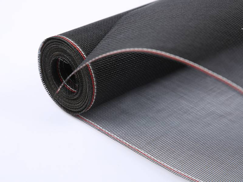 A roll of black fiberglass window screen.
