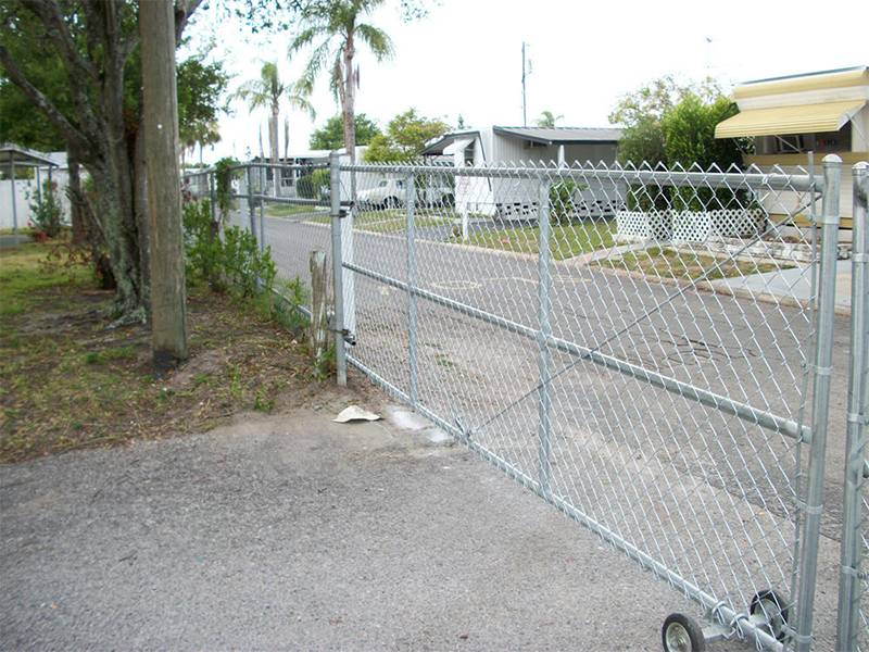 Chain link fence slide gate used in residential area.
