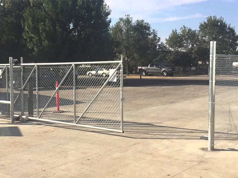 Galvanized chain link slide gate used in a public garage.