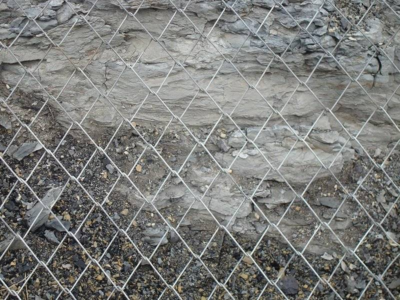 Galvanized chain link mesh used for mountain rockfall barrier.