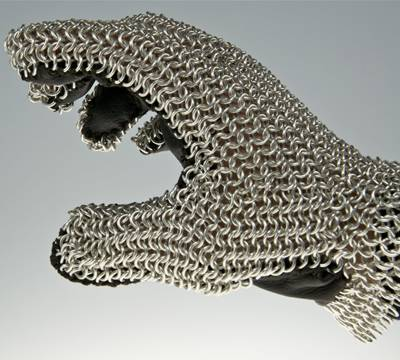 A chainmail gauntlet is constructed of leather and mild steel rings.