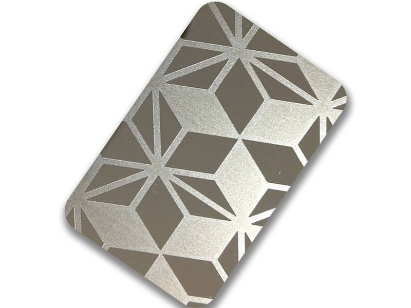 A close up of metal etching plate with diamond pattern.