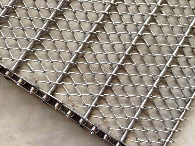 A part of chain link conveyor belt on the ground.