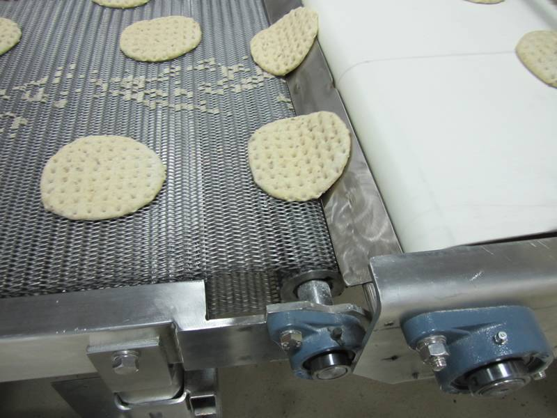 Stainless steel flat spiral conveyor belt for transporting biscuit.