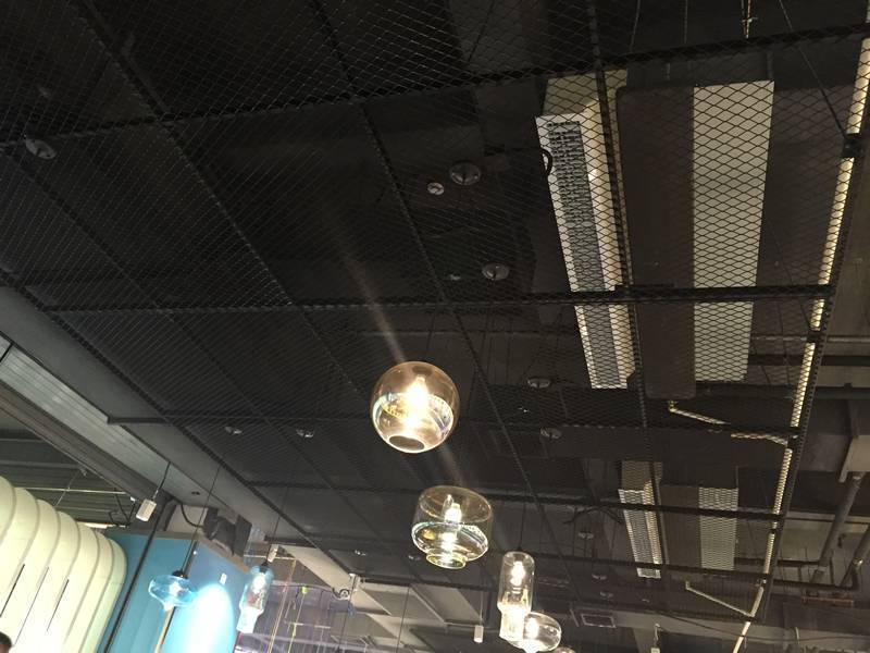 This picture is to show the black powder coated expanded metal ceiling, with several lights hung on it.