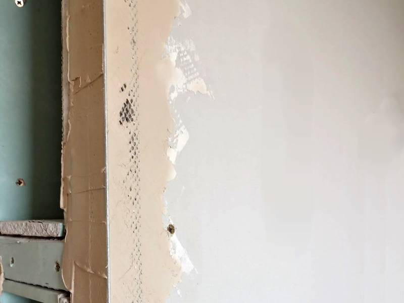 Expanded metal corner bead installed on the drywall.