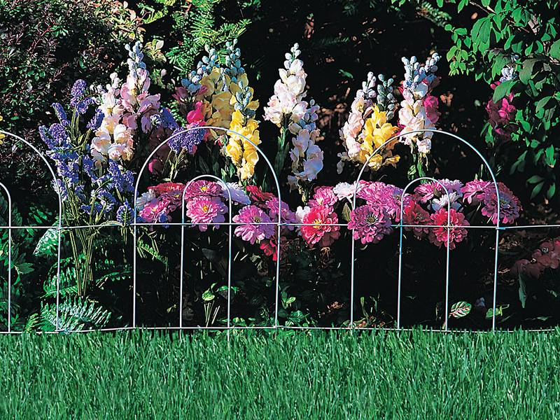 This is a garden with round garden border fence.