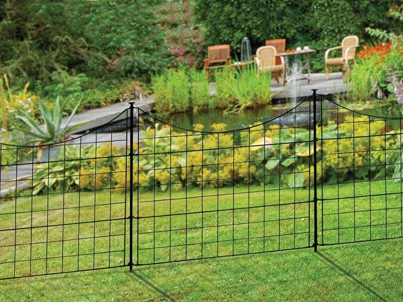 This is a beautiful garden with black welded wire garden fence.