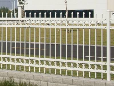 A picture of white garrison galvanized steel tubular fence with four cross beam and decorative rings.