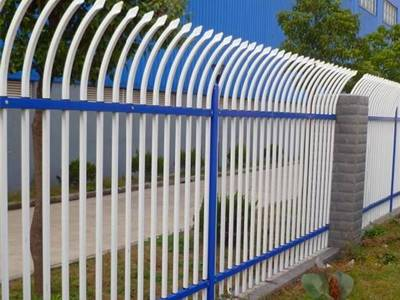 Blue and white garrison galvanized steel tubular fence with single curved head.