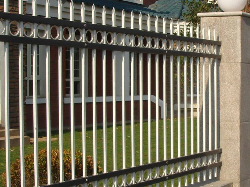 A close-up picture of hot-dip galvanized steel picket fence with spear-top and decorative rings.