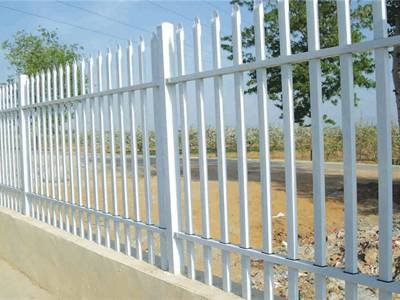 A picture of white garrison galvanized steel tubular fence with two cross beam.