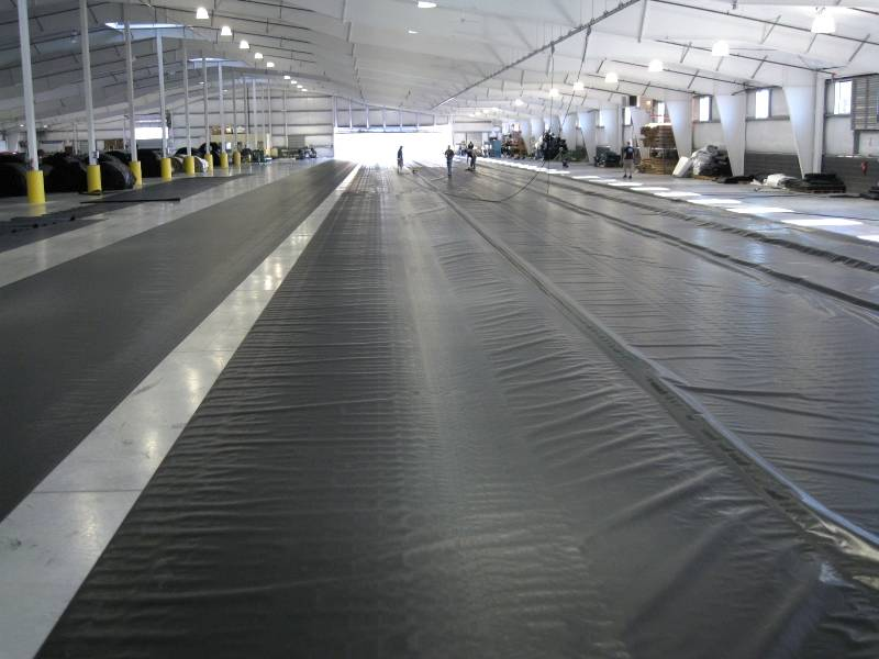 Many workers are setting the geomembrane in underground parking lot.