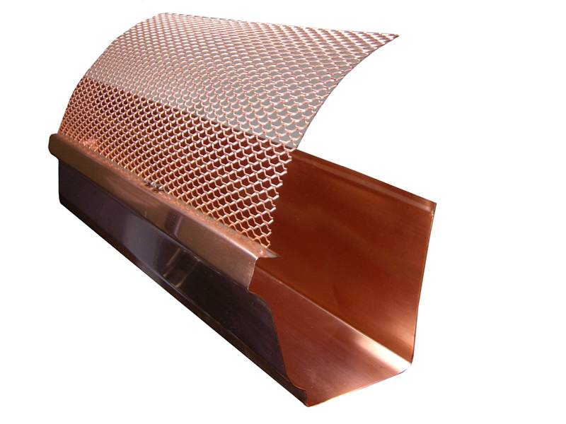 This is a copper gutter with hinged gutter guard.