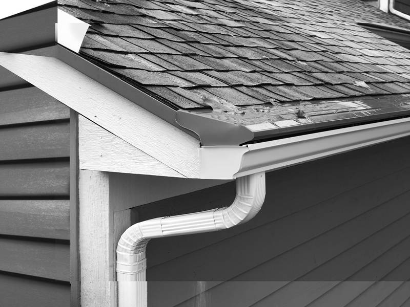 The gutter is installed in the roof with drainage pipe.