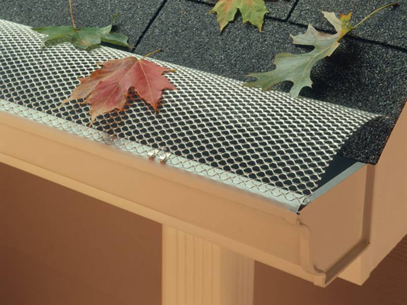 The hinged gutter guard is installed in roof with gutter.