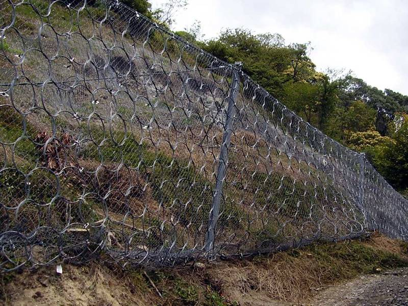 Steel ring net combined with chain link fence used to block the rocks.