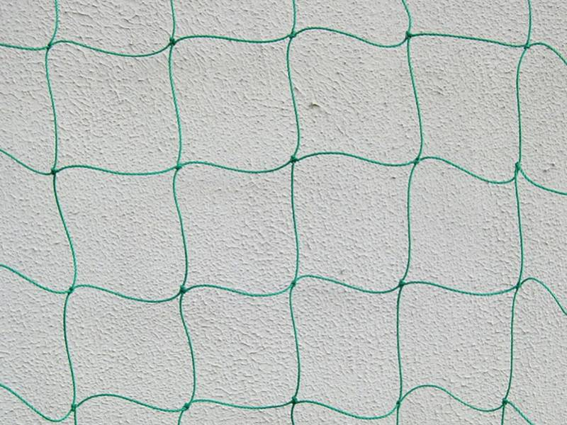 A piece of nylon trellis netting on the grey background.