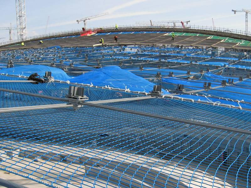 The blue personal safety net is used at construction site for workers operation.