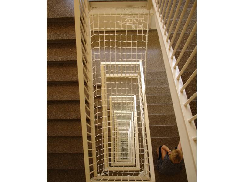 The personal safety net is used at stairway to make sure the people safe.