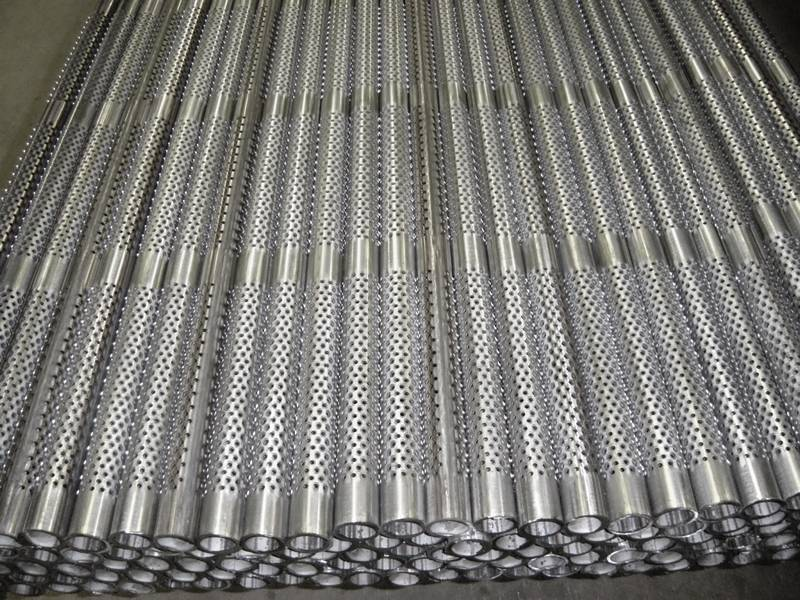 Many perforated casing pipes placed together orderly.