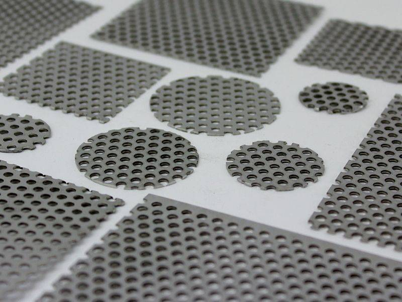 There are three rimmed filter discs constructed of single layer of woven wire mesh, and they three have different sizes.