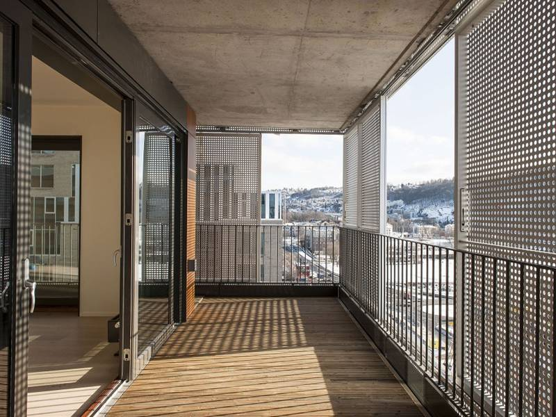 Perforated metal is made into balconies in a luxury building.