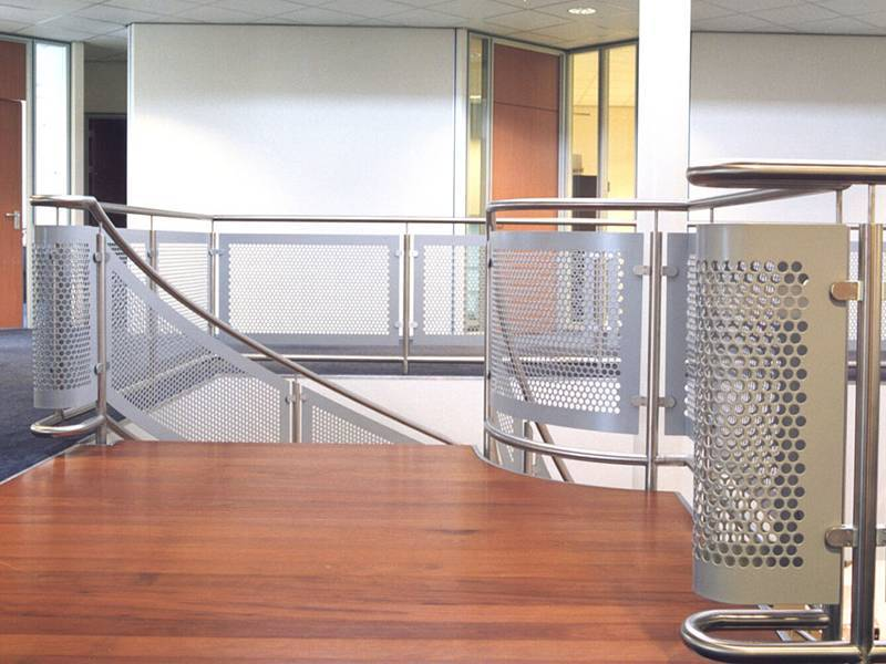 Perforated metal is installed as railing.