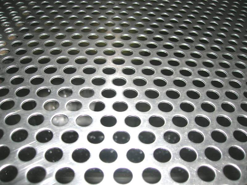 A part of perforated metal sheet to show round hole detail.
