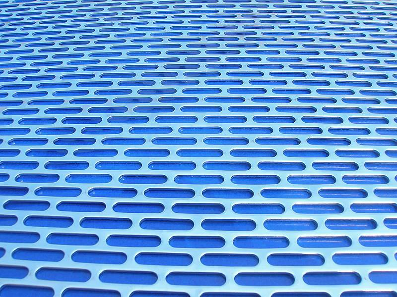 A part of perforated metal sheet to show slotted hole detail.