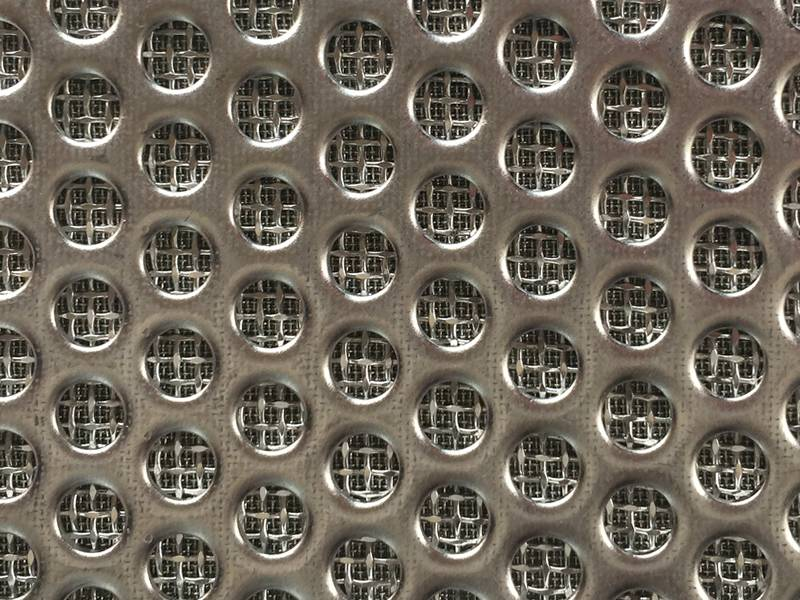 A piece of rectangular perforated sintered wire mesh.