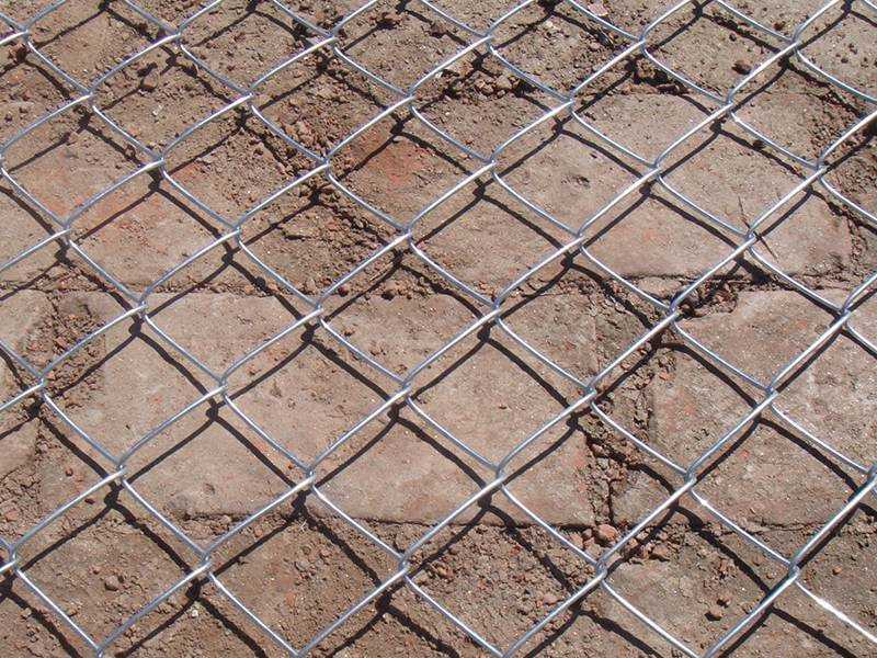 A piece of galvanized chain link plaster mesh.