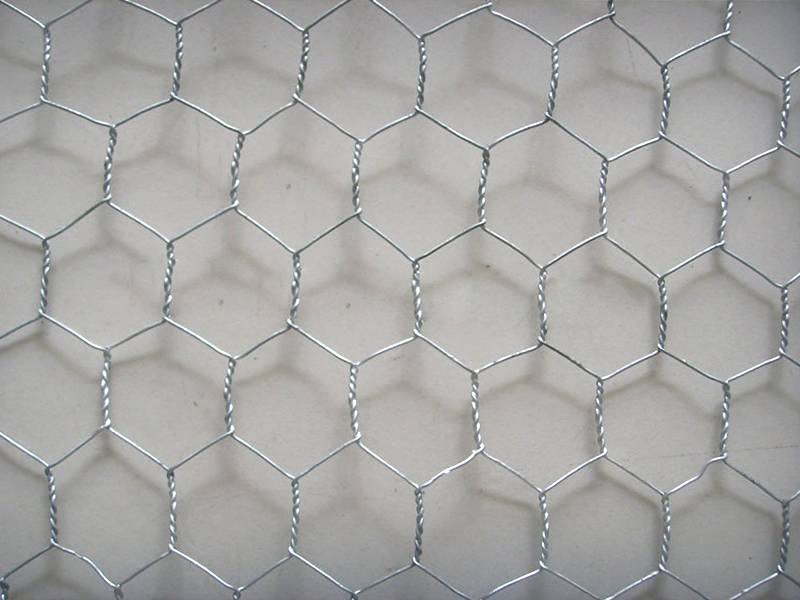 A piece of galvanized chicken wire plaster mesh with three twisted thin wire.