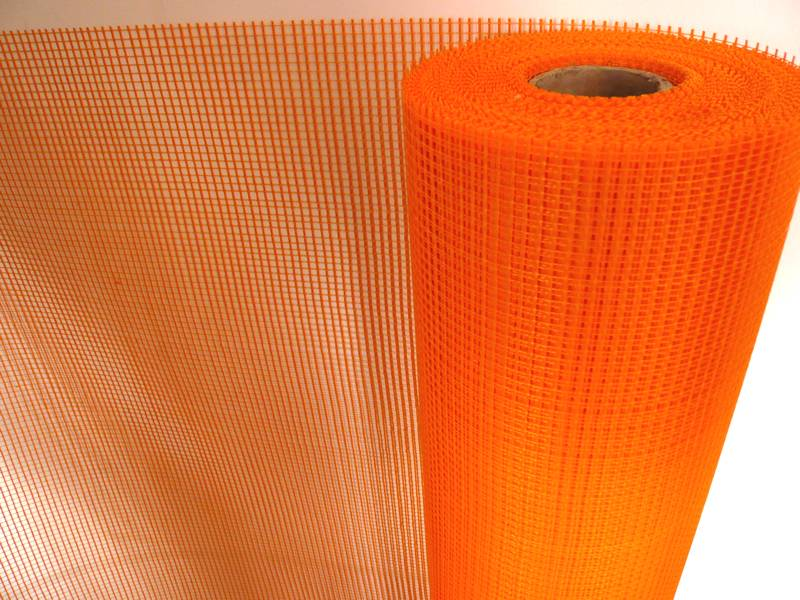 A roll of orange fiberglass plastering mesh.