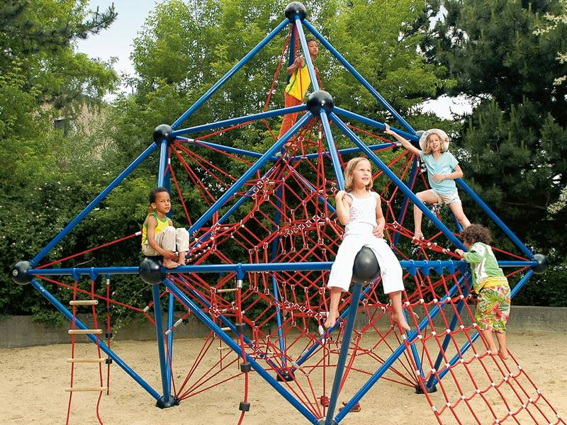 Five children are playing on a recreation facility which equipped with climbing net.