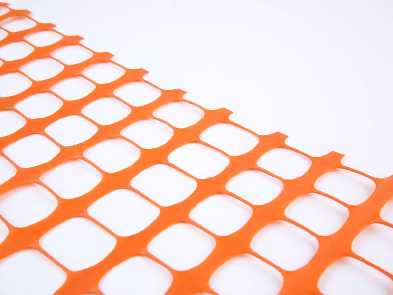 A part of plastic safety netting on the white background.