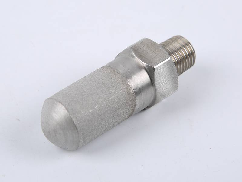 A sintered stainless steel powder filter element.