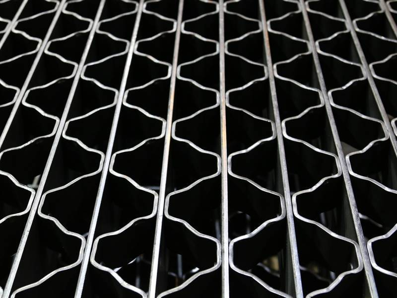 A riveted bar grating with smooth surface.