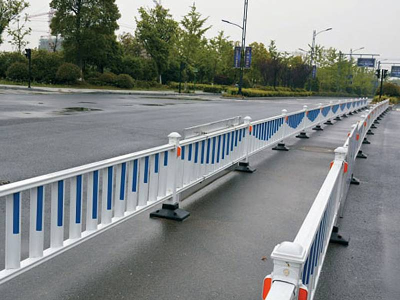 Traffic safety fence with blue and white color on the highway.