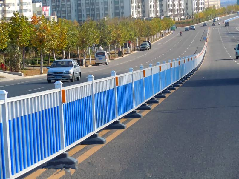 Flat top road fence coated with white and blue powder.