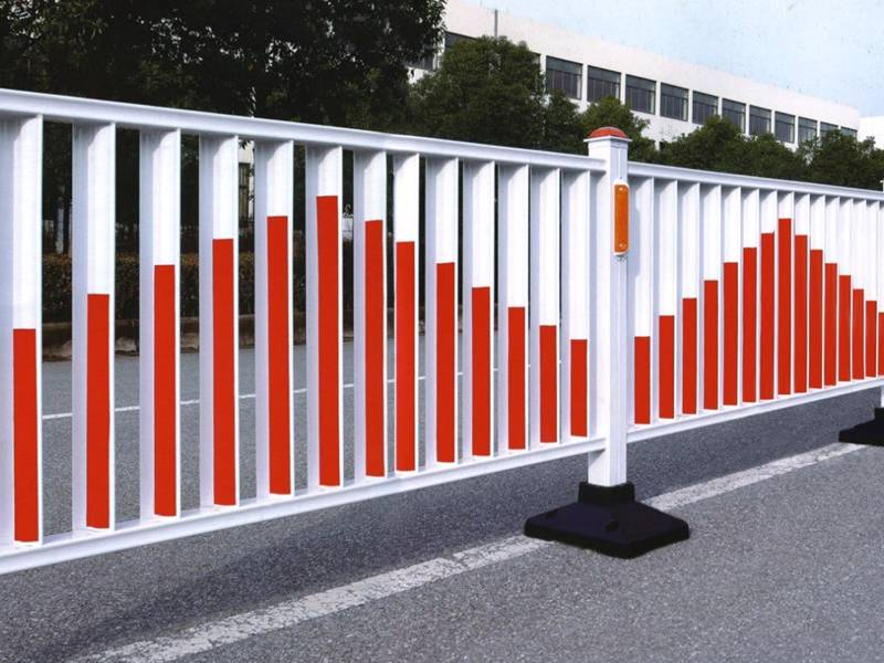 Two columns of flat top road fence with red color on the road.