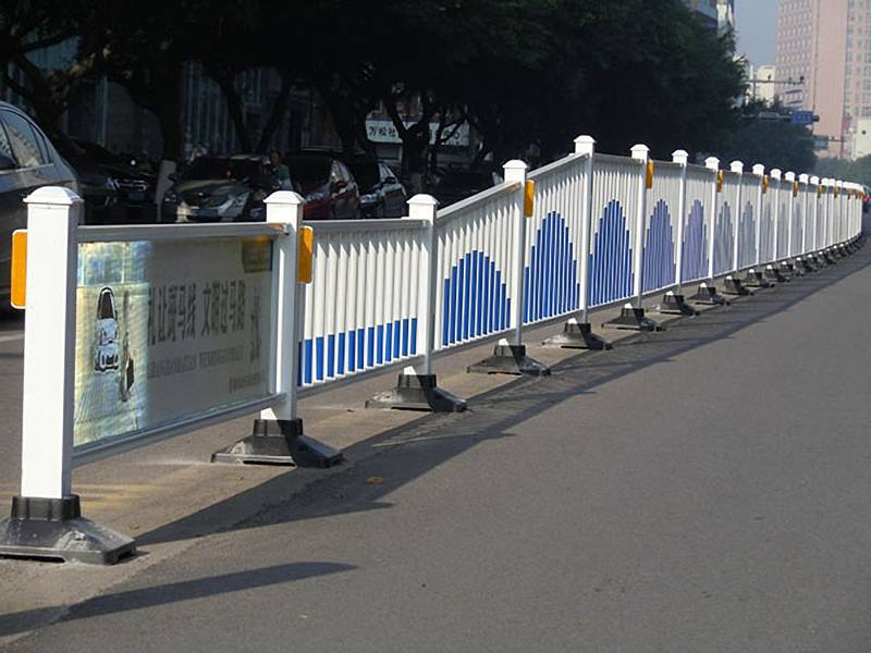 Blue color roadside traffic guardrail with advertising board.