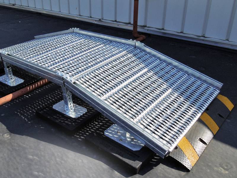 Diamond-Strut safety grating is used as a ramp in a factory.
